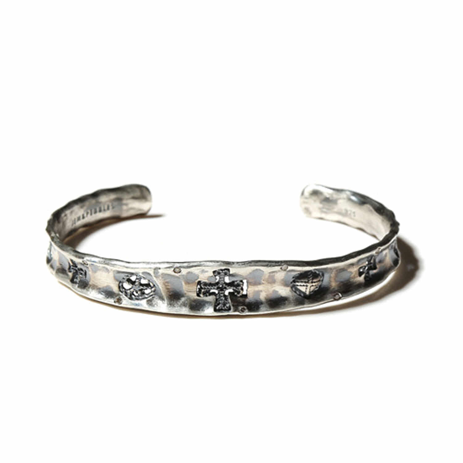 Cross glyph diamond cuff